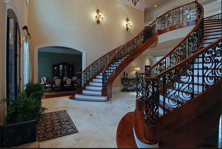 A curved staircase is your home s perfect focal point for Double curved staircase
